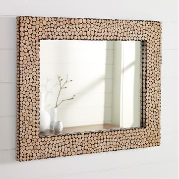 Adhere your mirror onto a surface that's oversized (this one is plywood I believe) and add cut up twigs. You could do the same thing with wine corks, nuts, etc.  Great texture! I think @Christopher Stowe Jennings might like this. Super cool.