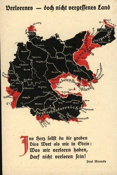 """""""Don't forget lost land!"""" """"In the heart of you, friends, engraved is this word as such as in stone: what we have lost will not be lost within you!"""" (Translation of the poster's text) This 1938 poster depicts a map of the Greater German Reich along with the territorial losses of ethnic German land from the Treaty of Versailles detailed in red. This was part of a campaign to garner public sympathy for Hitler's campaign of unifying all German-majority lands into the Reich."""