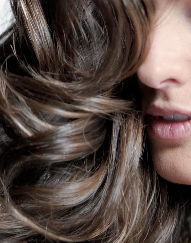 The prettiest way to add natural-looking dimension to light brown hair? Barely-there mini highlights in tonal hues.