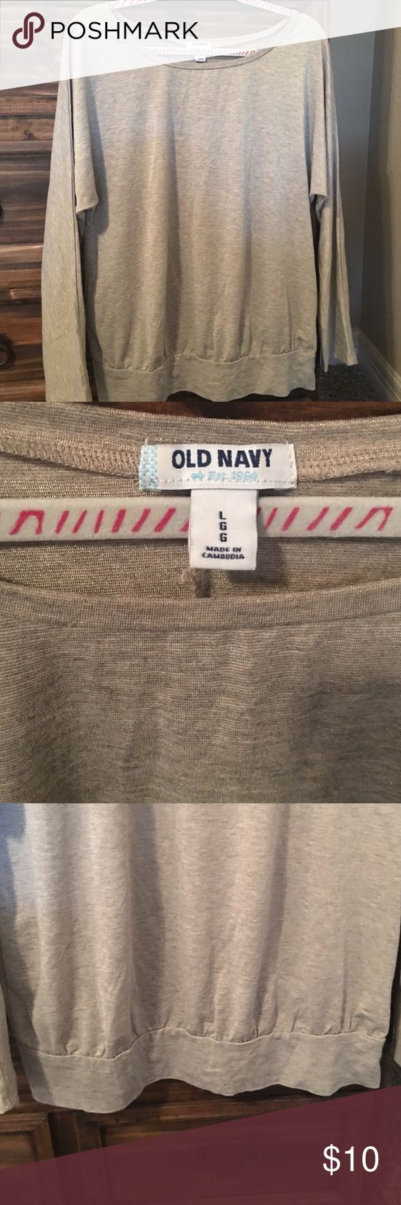 Old Navy long sleeve top size large Old Navy long sleeve top.  Size large.  Gold shimmer color,  long sleeve with banded waist band.  Worn once. Old Navy Tops Blouses