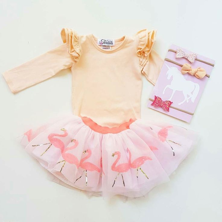 Peach!  Peach goes with everything! Available in tops and suits!