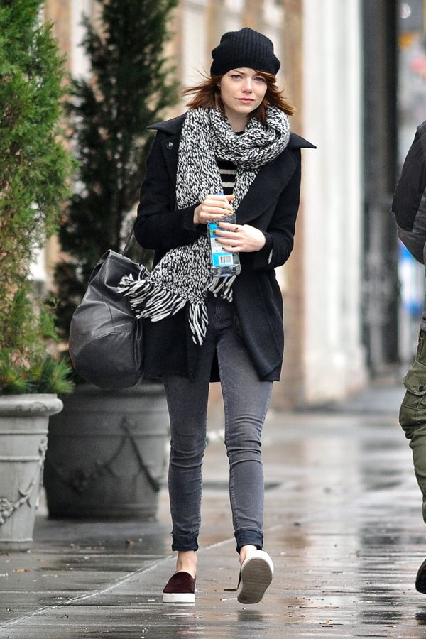 Emma Stone's Best NYC Outfits #refinery29  http://www.refinery29.com/2014/12/79691/emma-stone-best-new-york-outfits#slide9  With the sunny days of summer far behind us, Emma swapped her brown backpack for a more seasonally-appropriate hue. Ever since she made her big debut as Sally Bowles on Broadway, Stone has been spotted with this soft leather bag from COS draped on her shoulder. The gray fits in seamlessly with her muted cold-weather wardrobe — and the brand proves Stone is up-to-date…