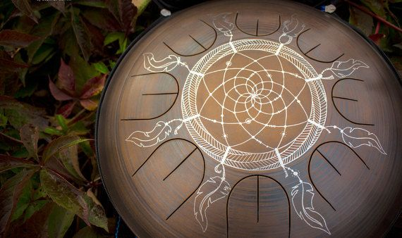 GUBAREV drum MINI with Overtones of Dream Catcher design. available scales for this instrument: Egyptian: A C D F G A C D African: A C D E G A C D Arcane: A C D E F G A C Rainbow: A B C# D E G A B Lalanta: A B C# D E F# G A Hijazz: A Bb C# D E F G A Ayaziska: A Bb C D E F G A Equinox A C# D E F# G# A C# ::::::::: Custom Scale on request ::::::::: I am glad to present you to a musical instrument. Our innovation consists in the method of tuning. Manipulation and forging of the tongue causes…