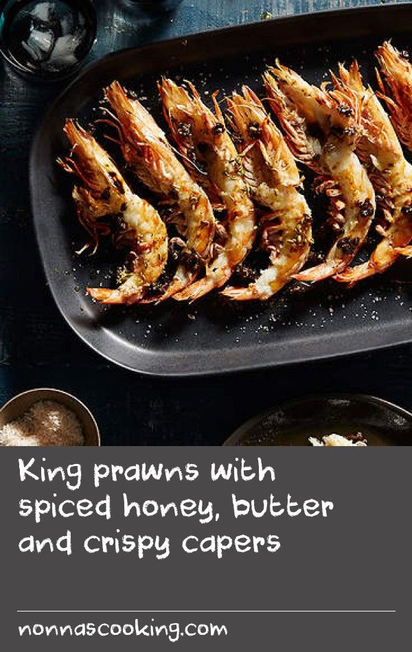 King prawns with spiced honey, butter and crispy capers | A prawn on the barbie screams Australia. I love the flavour a slightly charred shell gives and I especially enjoy the extra flavour you get from all the goodness found in a prawn head. This recipe can be just as easily done on a barbecue or chargrilled on your stove. Preparing prawns this way can be a little fiddly, but it's worth it as the shell protects the flesh and, once cooked, it's very easy to get to all the succulent meat.
