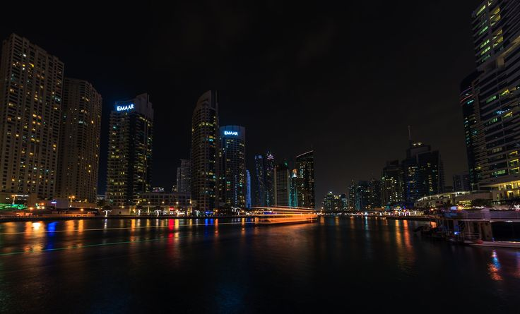 مرسى دبي No 2 - Dubai Marina (Arabic: مرسى دبي) is a district in Dubai, United Arab Emirates. Dubai Marina is an artificial canal city, built along a two-mile (3 km) stretch of Persian Gulf shoreline.[2] When the entire development is complete, it will accommodate more than 120,000 people in residential towers and villas. It is located on Interchange 5 between Jebel Ali Port and the area which hosts Dubai Internet City, Dubai Media City, and the American University in Dubai. The first…