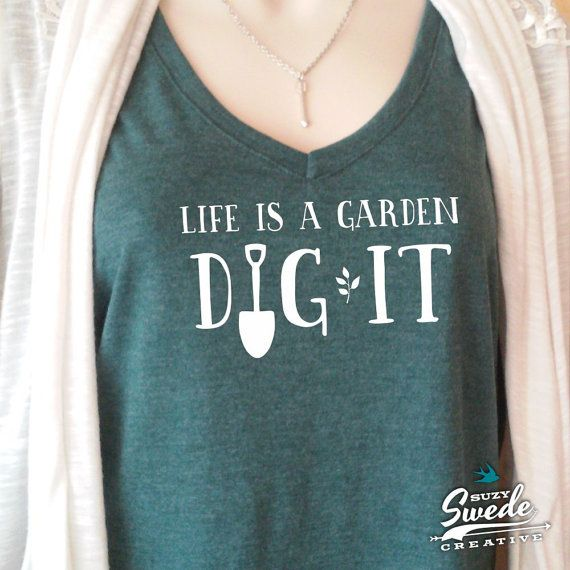 Life is a Garden, Dig It! Great gift for the happy gardener or backyard farmer. You cant help but look good in this fashionable blended V-Neck
