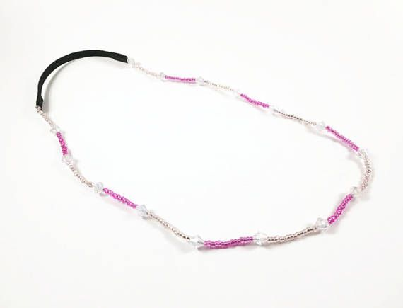 This beaded headband is the perfect hair accessory! An assortment of pink and clear beads were selected to create this headband. This versatile headband can also be worn as a necklace.