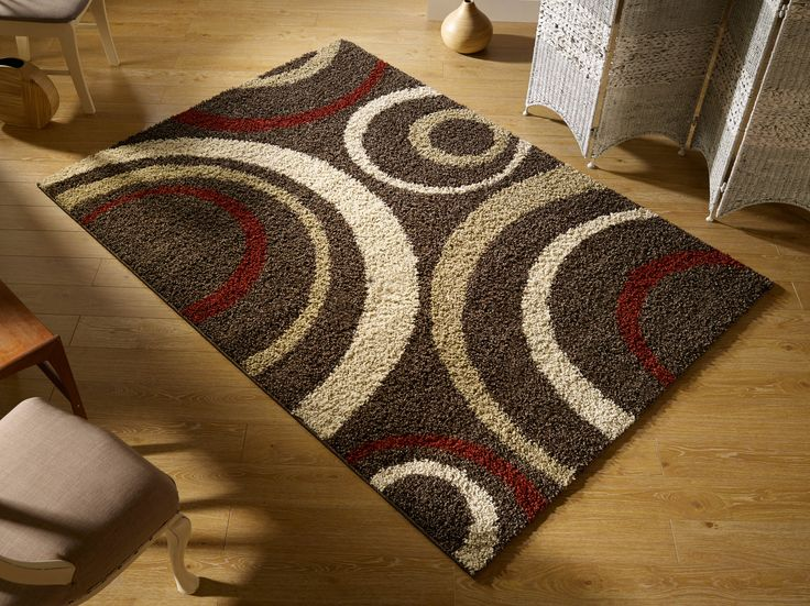 With modern floral designs and soft-cosy shaggy texture, this Aura Rug is a beautiful floor element for your room. #shaggyrugs #floralrugs #largerugs #modernrugs #largeshagrugs #largefloralrugs