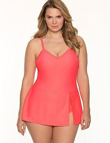 A modern swim dress that's anything but boring, this skirted maillot spices up the modest classic with a flattering V-neckline and slit skirt. Soft, wire-free cups offer light support in or out of the water, with adjustable, convertible straps to achieve your best fit. lanebryant.com