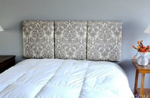 cover ceiling acoustical with fabric. Use a little batting under the fabric for a plusher look. Use velcro squares to hand on the wall for a wall mounted headboard that will travel with you to your next home.