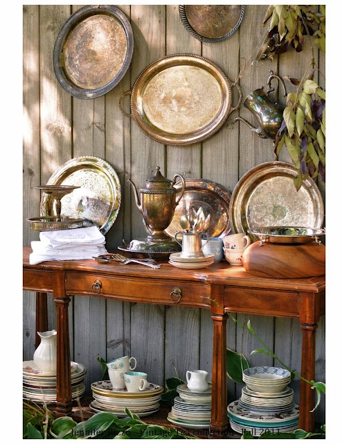 I love stacks and stacks of mismatched, chipped dishes. I need to find a table like this that will hold my dishes. Of course, I probably won't keep it outside next to the fence. LOL