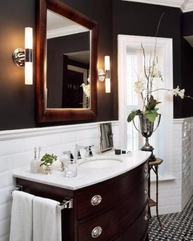 kind of like those sconces.  love the brown wall color. I think I like the subway tiles too, but a simple wainscoting could give a similar effect.
