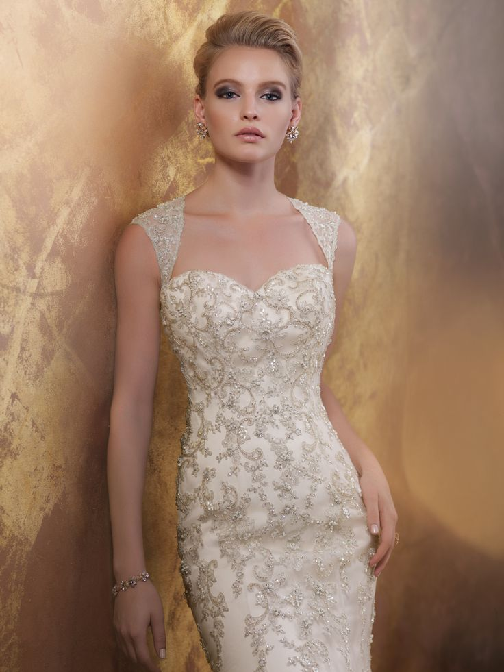 James Clifford | Style No. › J11578 | Wedding Dresses 2015 Collection – Hand-beaded and embroidered lace appliqué and tulle over satin fit and flare wedding dress with illusion cap sleeves, Queen Anne neckline, dramatic open keyhole back, scalloped hemline, chapel length train. Sizes: 2 – 20