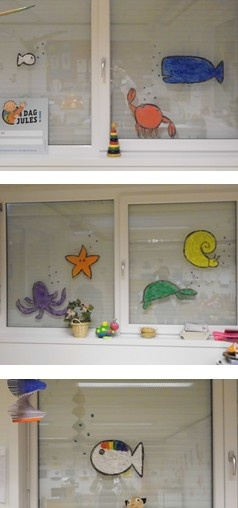 "The story of ""Klein wit visje"" painted on the windows of my classroom!"