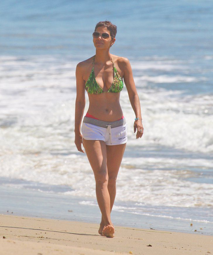 Pin for Later: Halle Berry's Hottest Bikini Moments!  Her toned abs were on full display during a walk along the Malibu coast in March 2011.