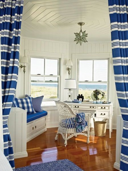 LOVE the beach-i-ness of this space, but would need a bigger desk top! :)