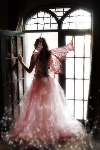 This picture inspired me to consider making a fairy with translucent dress with glass beads that might be illuminated when set over a battery operated candle.