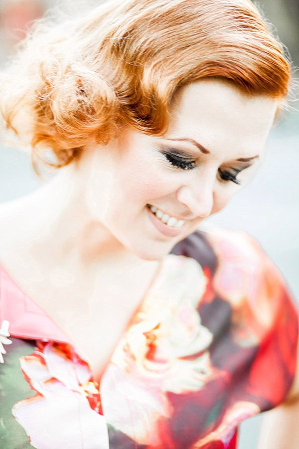 Semi permanent fake lash extensions by Boudoir Lashes. Floral 1940s style dress by Ted Baker.  Red hair. Vintage style hair. Smoky eye makeup.  Photography by Naomi Kenton - http://www.naomikenton.co.uk