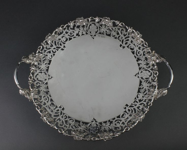 Lot 560, A good pierced, chased and cast 2 handled silver tazza with vinous decoration. Sheffield 1939 1364 grams, sold for £700