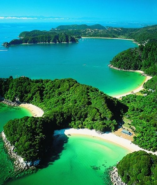 Abel Tasman National Park -  we went here for our honeymoon.  In fact, that's the very beach in the foreground there that we camped after sea kayaking to get there.  No roads!