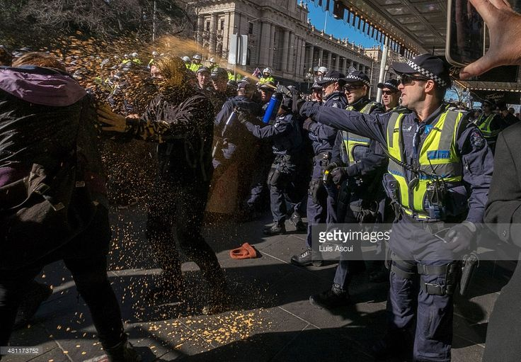 Police use pepper spray on anti 'Reclaim Australia' protesters during a rally on July 18, 2015 in Melbourne, Australia. 'Reclaim Australia' grassroots rallies are being held across Australia to protest the alleged 'Islamisation' of Australia…  Credit: Luis Ascui