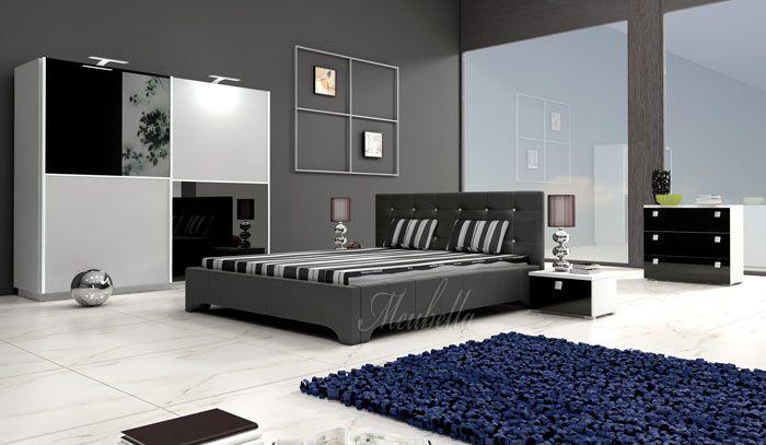 Bed Roxynta - Zwart Tweepersoonsbed vervaardigd uit zwart pellini-leder met witte accenten in het hoofdeinde. Het bed wordt met lattenbodem geleverd. Matras wordt niet meegeleverd.  http://www.meubella.nl/slaapkamer/bedden/2428-bed-roxynta.html