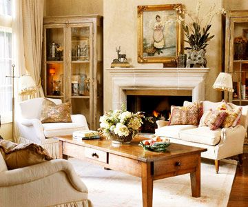 Old Is New--the precious painting whispers french country love it.Old Is New  Incorporating antiques into a room lends an authentic Country French look. Pillows covered in antique fabrics stand out against cream upholstered pieces in the living room. The hutch and fireplace mantel display other antique treasures.
