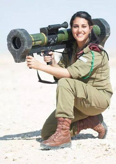 IDF Women. with AT-4 shoulder fire weighs about 12 lbs, recoilless, wont knock her over at all.
