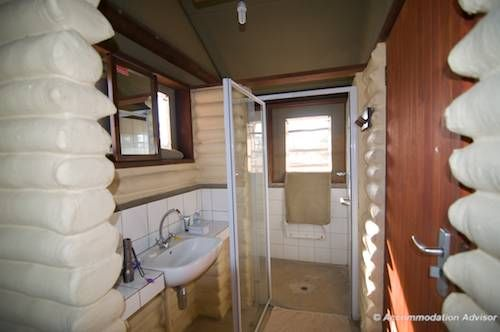 The bathroom at Grootkolk Camp has a shower, toilet and basin.