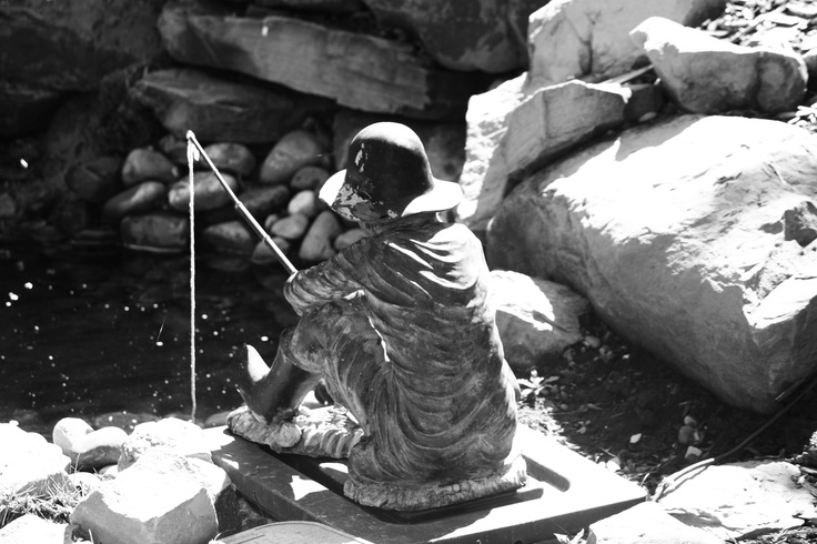 Black and White fisherman statue