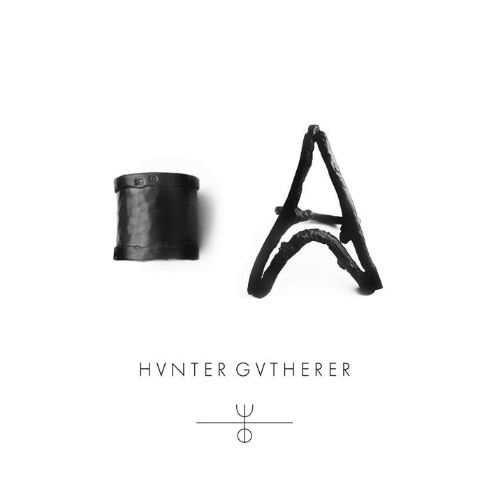 HVNTER GVTHERER offers contemporary accessories crafted from precious and non-precious materials. Ranging from staples to statement pieces in a palette of rich blacks, muted grays, and weathered metallics, HVNTER GVTHERER's line is diverse in form and designed to complement a variety of tastes and lifestyles. The handcrafted process leaves a landscape of unique imperfections on the surface of each piece that change subtly over time and reveal a distinctive, inner beauty.