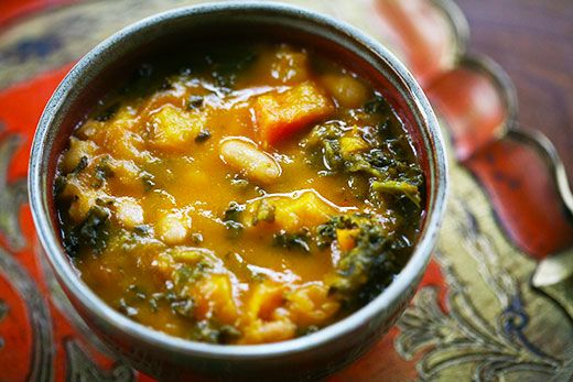 Kale and Roasted Vegetable Soup Recipe Soups with carrots, tomatoes, onion, butternut squash, garlic cloves, olive oil, vegetable broth, kale, thyme sprigs, bay leaf, white beans
