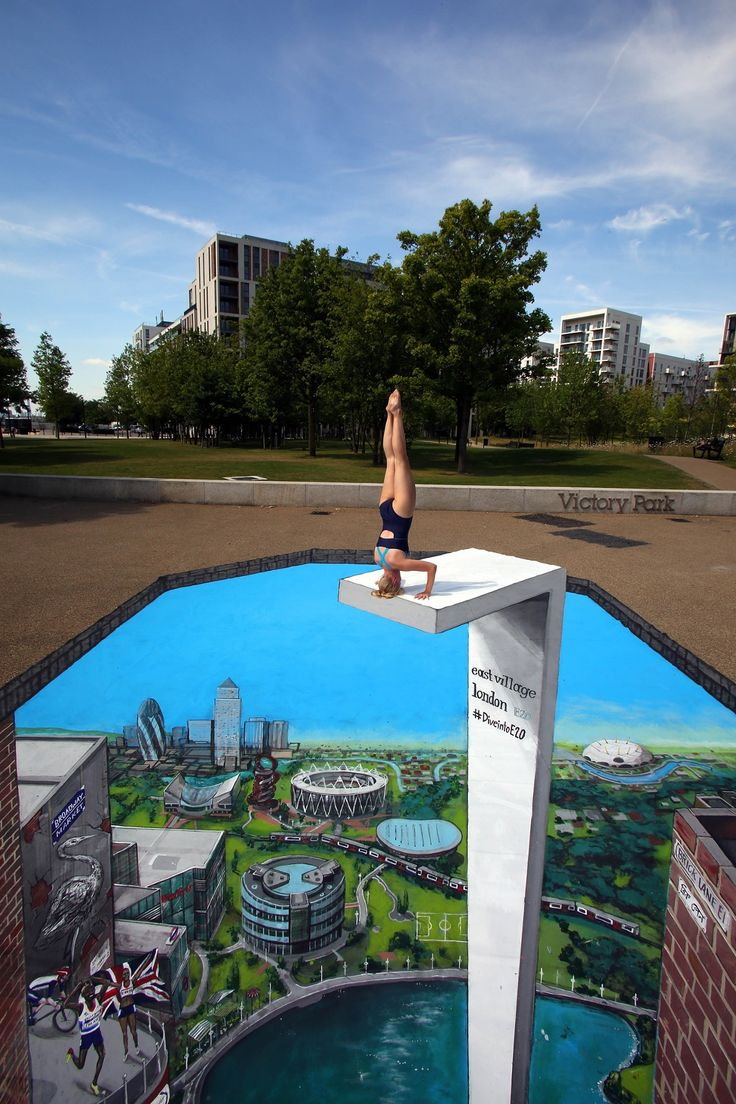 Swimmer Tegan Jolly prepares to 'dive' into a piece of 3D artwork created by artists Joe and Max, in Stratford, east London. via Look out below! 3D pavement art around the world – in pictures
