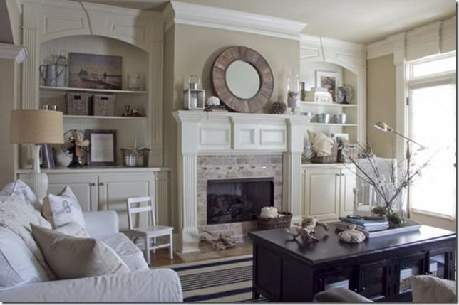 Taupe or pale green walls make this room peaceful but welcoming.  Great mirror on mantel.