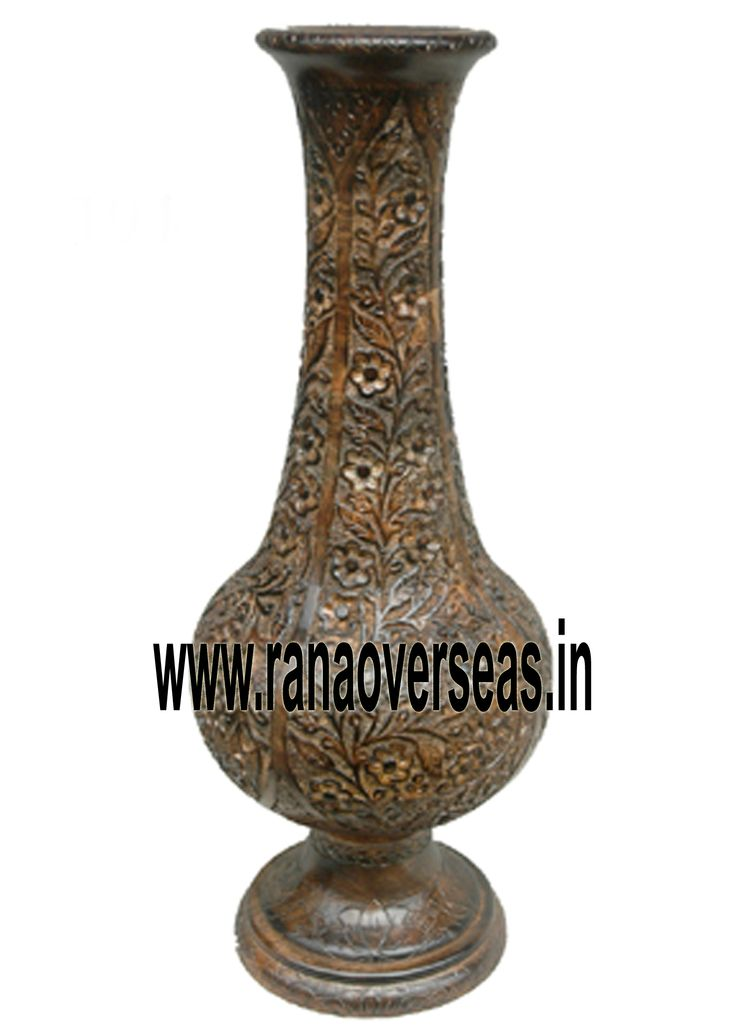 Wooden Flower Vase Rana Overseas leading manufacturer, exporter and supplier of Wooden Flower vases.Wooden flower vases designed by artist beautifully showcase the traditional as well as modern designs. Wooden Flower vases are designed in styles ranging from exquisite to outrageous ones. These Flower vases chiseled out of variety of materials in varied shapes are extremely eye-catching with their compelling beauty. The Wooden flower pot base is made heavy to provide support to its body.
