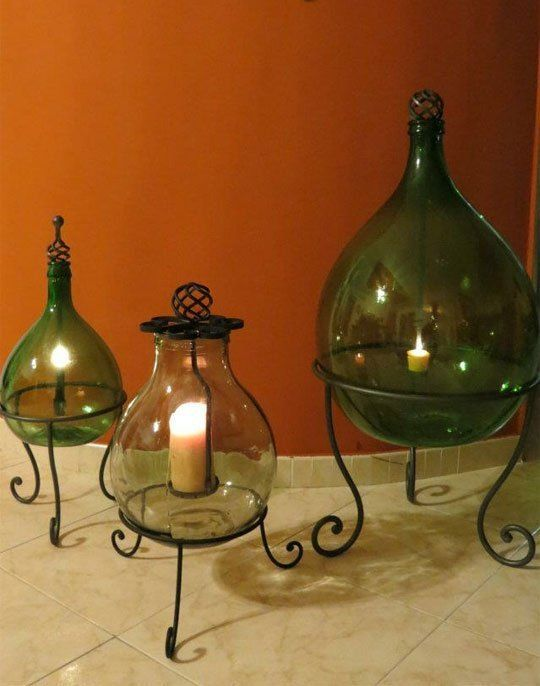 Lanterne fatte con damigiane verdi