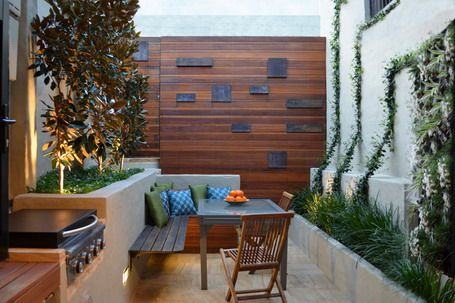Corner Wooden Seating With Cushions In Contemporary Patio