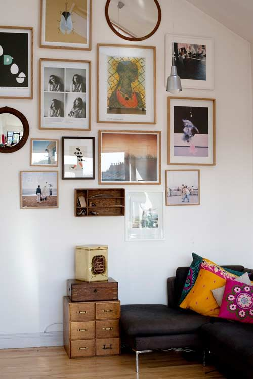 photo / art / print / mirror wall display and colorful pillows on a basic sofa
