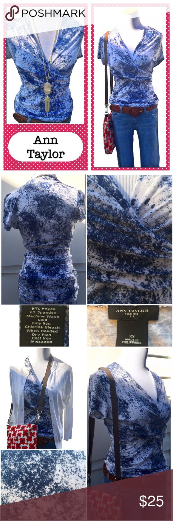 """Ann Taylor Crossover Top Blue & White Short Sleeve This adorable Ann Taylor XS blue and white cross over short sleeve top has a white background with splatters of blue. It's mostly a navy blue. It's in very good used condition with no flaws, stains or pilling. It has some ruching where the top crosses over at the side. 94% rayon, 6% spandex. Machine Wash cold. I love this shirt! Very flattering. Approximate flat measurements: pit to pit 16""""; Length about 26""""  Shown with other listings: Orla…"""