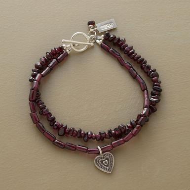 "Garnets two ways: one strand of chips another of cylinder beads. The latter dangles a sterling silver heart charm. Toggle clasp. Ours exclusively, handcrafted in USA. Approx. 7-1/2""L."