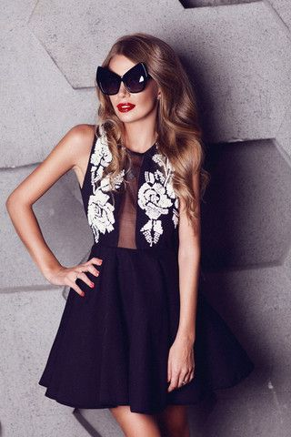 Black mini dress embroidered with sequins. Enhance the feminine silhouette and wear yours with heels.