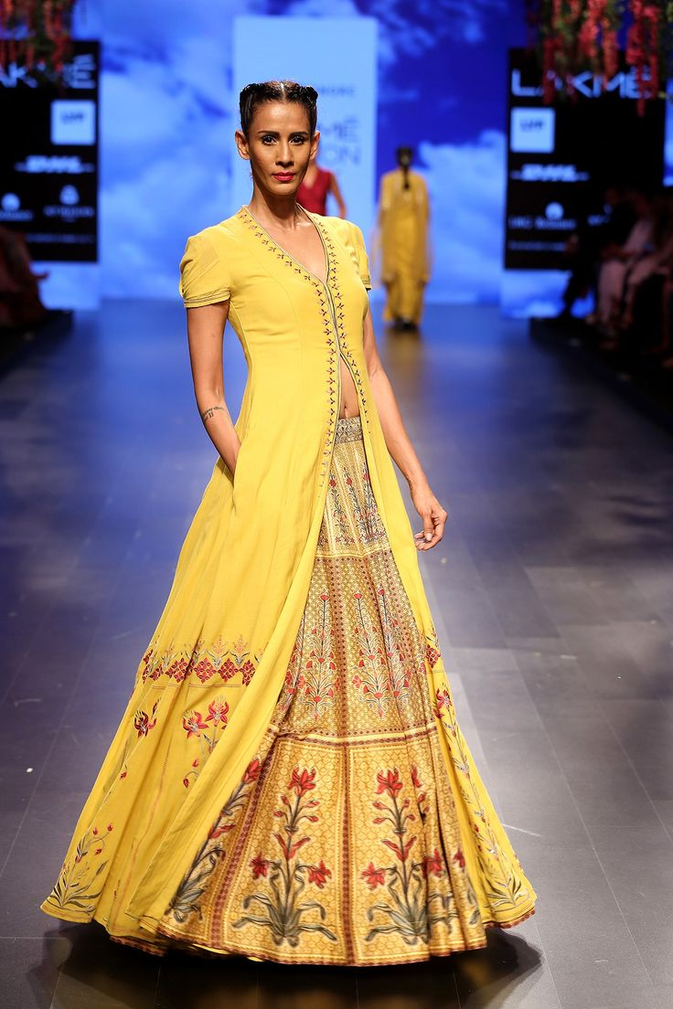 A striking mustard yellow cotton georgette, short sleeved jacket, highlighted with berry pink resham and gota patti embroidery paired with a panelled digital print chanderi floral yellow lehenga.INR 95,000.00