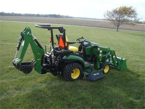 2012 JOHN DEERE 1026R with factory installed loader/backhoe. 25HP Diesel engine and flat iron quick install mowing deck.