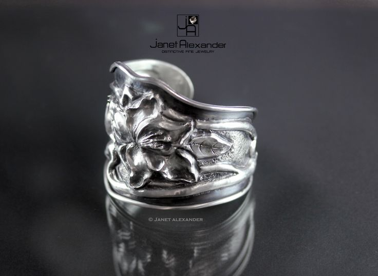 Chase and Reposse flower cuff made of Argentium Sterling Silver by Janet Alexander.