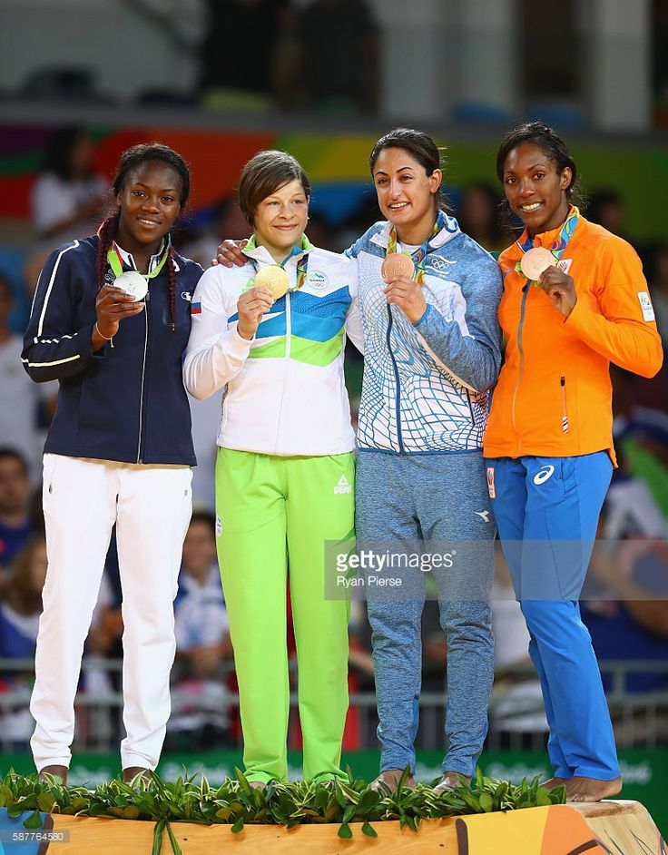 Silver medalist Clarisse Agbegnenou of France, gold medalist Tina Trstenjak of Slovenia and bronze medalists Yarden Gerbi of Israel and Anicka van Emden of the Netherlands pose on the podium during the medal ceremony for the Women's -63kg on Day 4 of the Rio 2016 Olympic Games at the Carioca Arena 2 on August 9, 2016 in Rio de Janeiro, Brazil.