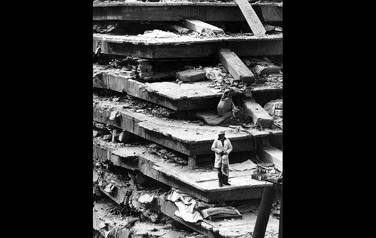 Sept. 20, 1985: A man pauses on wreckage of the General Hospital in Mexico City following an 8.1 earthquake on Sept. 19, that flattened the building, killing 277.