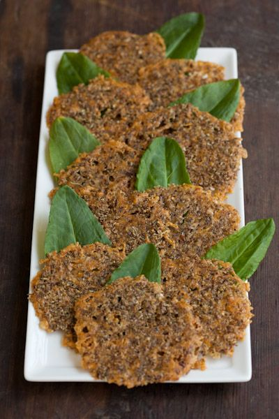 Low carb Cheese Crisps or Crackers 1/4 cup grated Parmigiano Reggiano, 1/4 cup grated sharp cheddar cheese, 2 tablespoons flax seed meal, 1/2 teaspoon Italian Seasoning, dash of black pepper