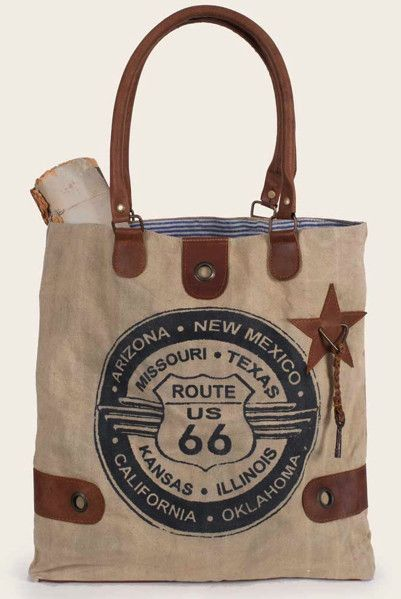 Description: Whether you're taking the backroads or Route 66, you will always be stylish with this classic Route 66 printed canvas bag. This smaller canvas tote bag features a ticking lining. No insid