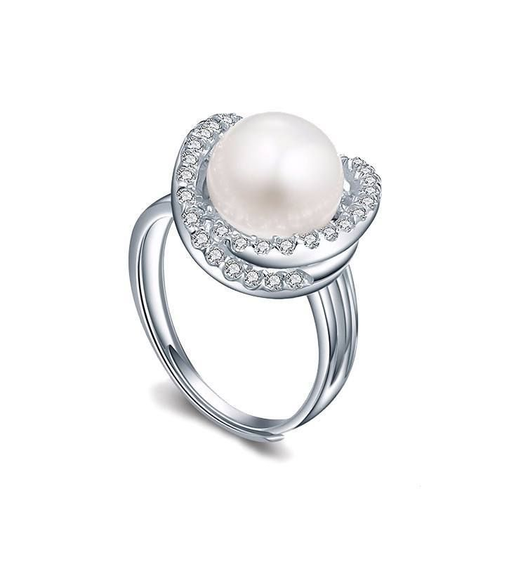 *Free shipping worldwide* This white synthetic pearl and cubic zirconia ring makes its own modern statement. These details single out our cocktail ring as a contemporary classic.   bridal ring   wedding ring   bridesmaid ring   prom ring   silver ring   white pearl ring   bridal jewelry   wedding jewelry   prom jewelry   bridal jewellery   wedding jewellery   prom jewellery