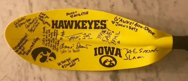 Amanda and Collin love kayaking and both went to University of Iowa. So for their special gift I bought a full size Kayak paddle. Then I called the University bookstore and ordered some Hawkeyes decals which I added to each paddle. All the guests signed the paddles. We're all about people!